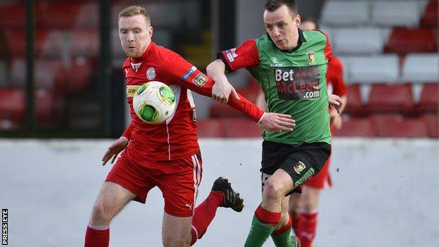 Cliftonville's Chris Curran and Glentoran's Janson Hill in action at the Oval
