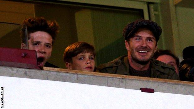 David Beckham watching from the stands as Wayne Rooney scores