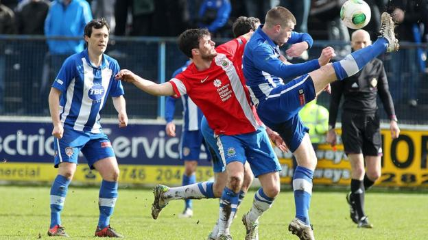 Linfield midfielder Philip Lowry competes against his brother - Coleraine's Stephen Lowry - during the 0-0 Irish Premiership draw at the Showgrounds
