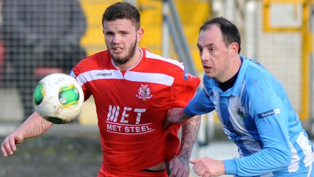 Portadown forward Darren Murray and Jonathan Cowan of Warrenpoint keep their eyes on the ball during the Premiership clash at Shamrock Park