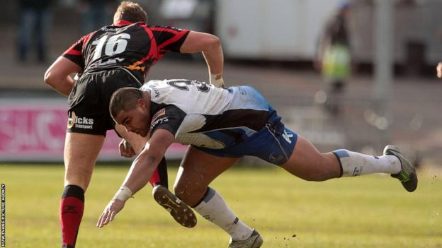 Dragons replacement Elliot Dee is tackled by Connacht's Rodney Ah You.