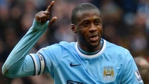 Manchester City midfielder Yaya Toure celebrates scoring against Fulham