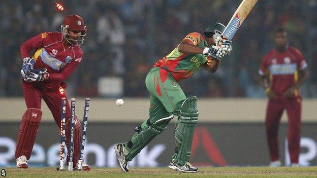 Bangladesh batsman Shakib Al Hasan is bowled by Krishmar Santokie
