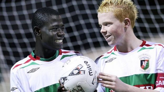 Afriyie Acquah shares a joke with a Glentoran team-mate during his time with the club
