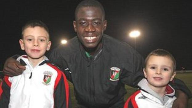 Afriyie Acquah, aged 15, with Sam Robinson's two sons Jack (left, then aged eight) and Jordi (right, then five) in 2007