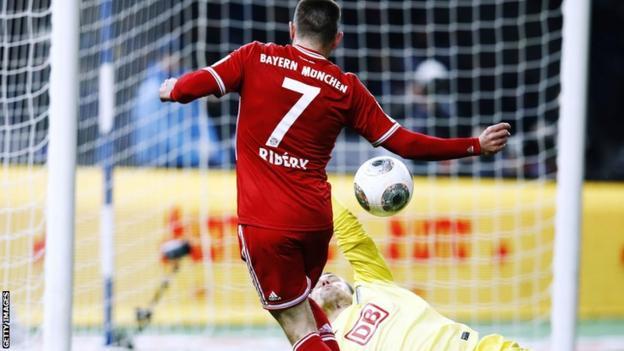 Bayern Munich player Franck Ribery scores against Hertha Berlin