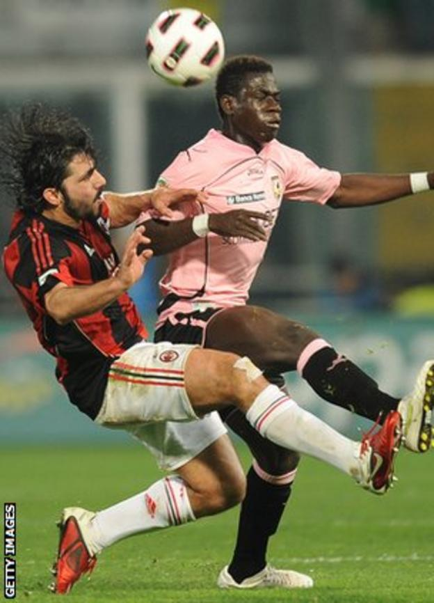 Afriyie Acquah (in pink) in action for Palermo against AC Milan in 2011