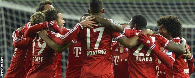 Bayern Munich's players celebrate winning the Bundesliga title