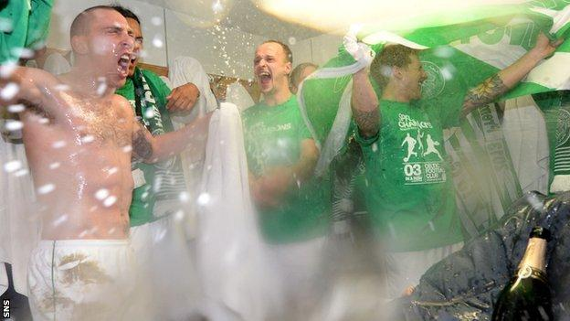 Celtic players celebrate in the dressing-room