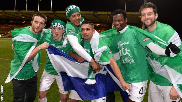 Celtic players celebrate their title success at an empty Firhill