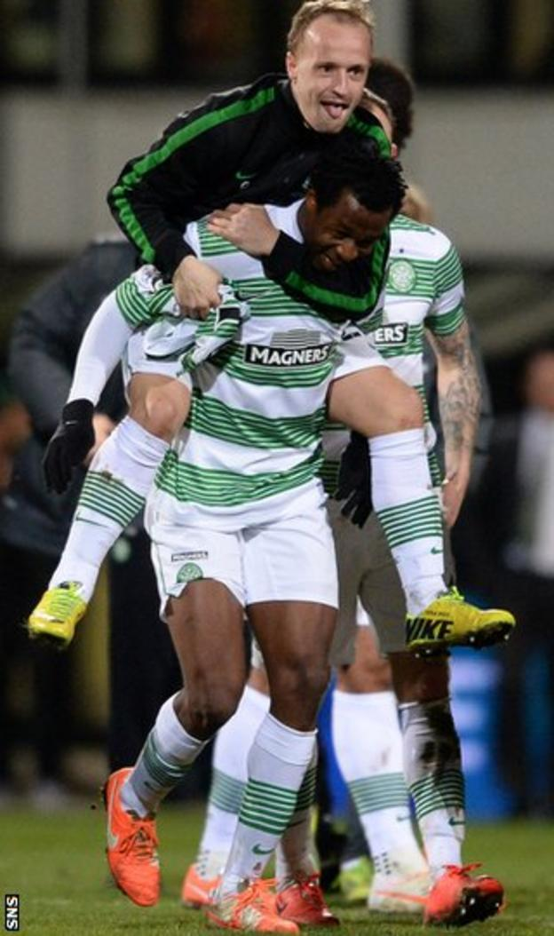 Leigh Griffiths and Efe Ambrose celebrate Celtic's title win