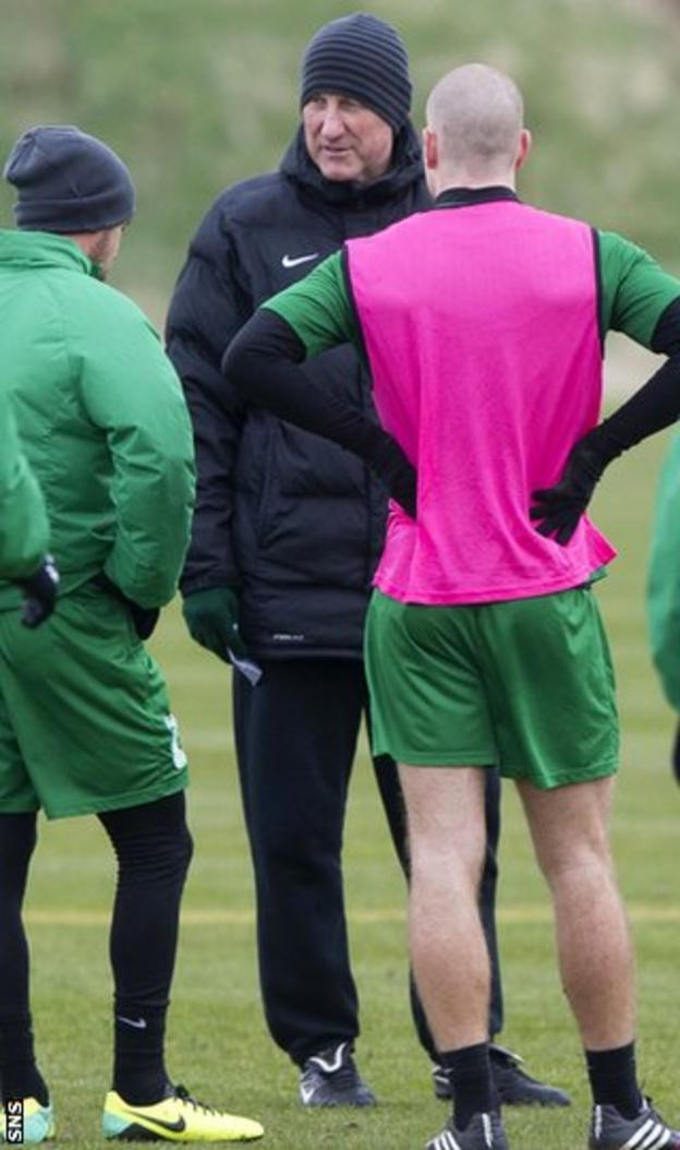 Hibs manager Terry Butcher talks to his players during training