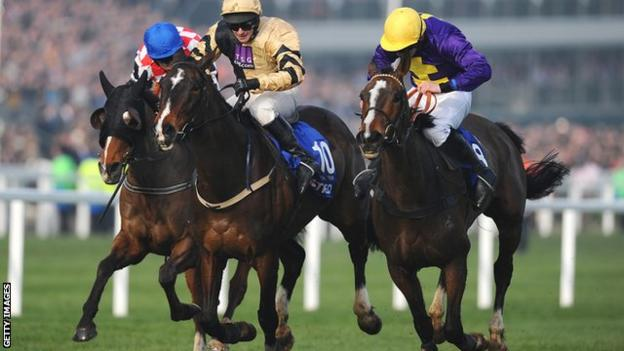 Davy Russell on Lord Windermere (right) surges ahead to win the Cheltenham Gold Cup from On His Own (centre) and The Giant Bolster (left)