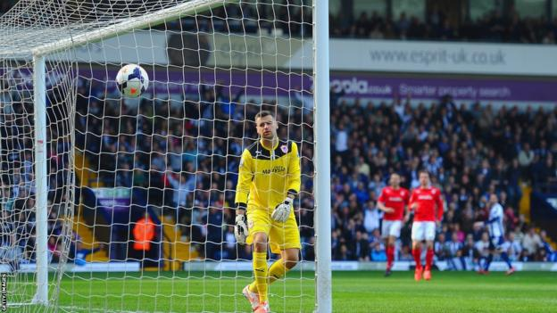 Cardiff goalkeeper David Marshall can only look on in despair after being beaten by a brilliant chip from West Bromwich Albion midfielder Morgan Amalfitano