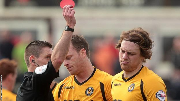 Newport's Adam Chapman is shown a straight red card for a two-footed lunge against a Portsmouth player