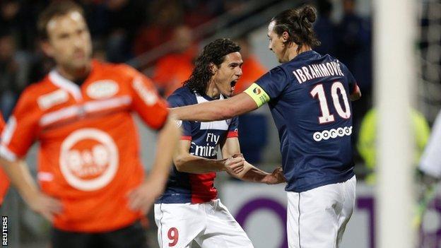 Paris St-Germain's Edinson Cavani celebrates with his team-mate Zlatan Ibrahimovic