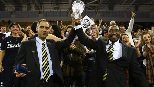 Worcester coach Paul James (right) lifts the BBL Trophy after beating Glasgow.