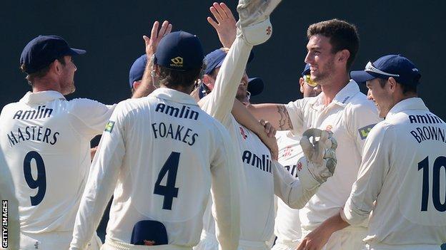 Essex players celebrate a wicket