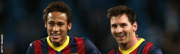 Neymar (L) and Lionel Messi of Barcelona walk off in good spirits following their team's victory at the end of the UEFA Champions League Round of 16 first leg.
