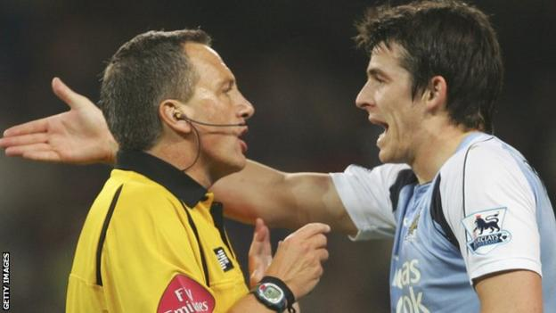 Joey Barton makes a point to referee Alan Wiley playing for Manchester City in 2007