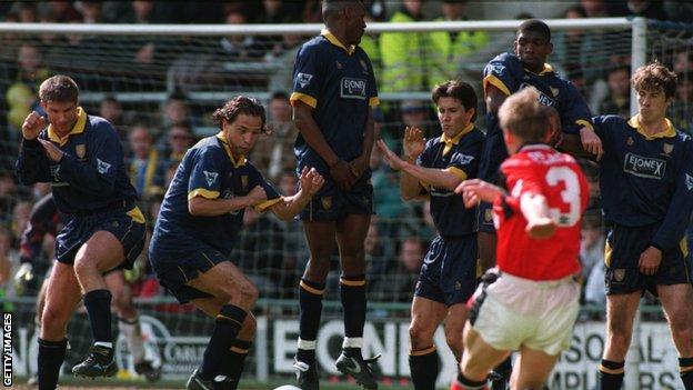 Stuart Pearce scores a free kick