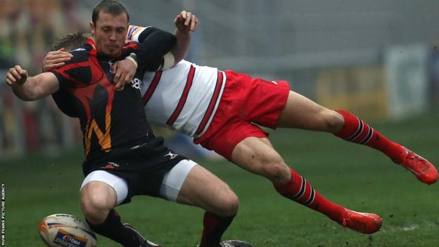 Newport Gwent Dragons scrum-half Richie Rees, in action against former club Edinburgh, is tackled by Tom Brown in the rearranged Pro12 match at Rodney Parade.