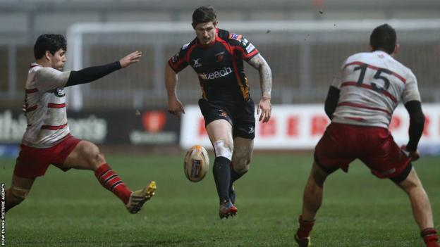 Dragons try scorer Ross Wardle kicks the ball during his side's Pro12 defeat at home to Edinburgh.
