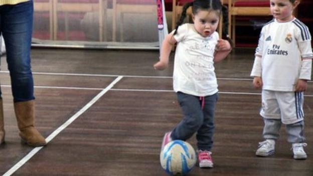 Toddlers playing football