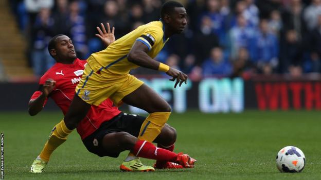 Cardiff City defender Kevin Theophile-Catherine battles for the ball with Crystal Palace's Yannick Bolasie during Saturday's Premier League game at Cardiff City Stadium.