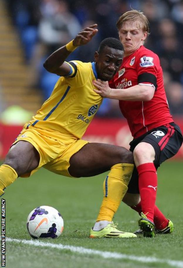 Palace's Yannick Bolasie holds off Cardiff's Mats Moller Daehli