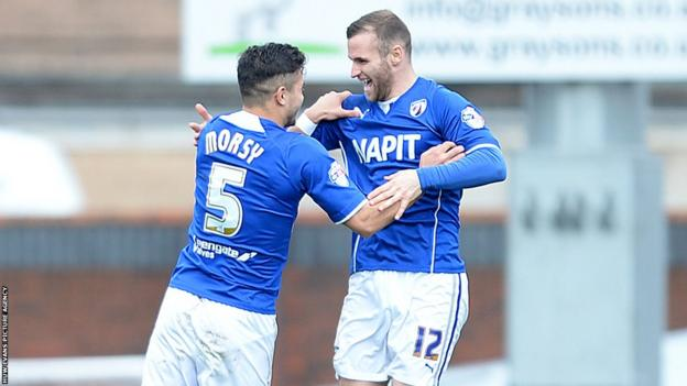 Jimmy Ryan celebrates with team-mate Sam Morsy after giving Chesterfield the lead against Newport County.