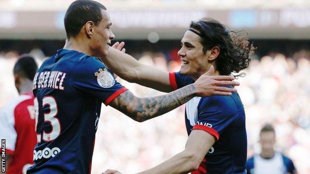 Paris's Dutch defender Gregory Van der Wiel (left) and Paris' Uruguay forward Edinson Cavani