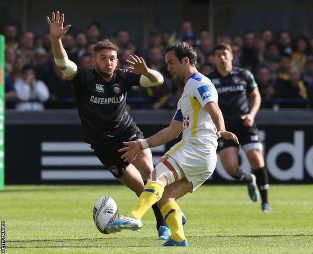 Clermont Auvergne's Morgan Parra kicks the ball past Leicester's Welsh fly-half Owen Williams during the Heineken Cup quarter final at Stade Marcel Michelin.