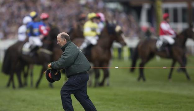 Starting tape is stretched across the course after a false start to the Grand National