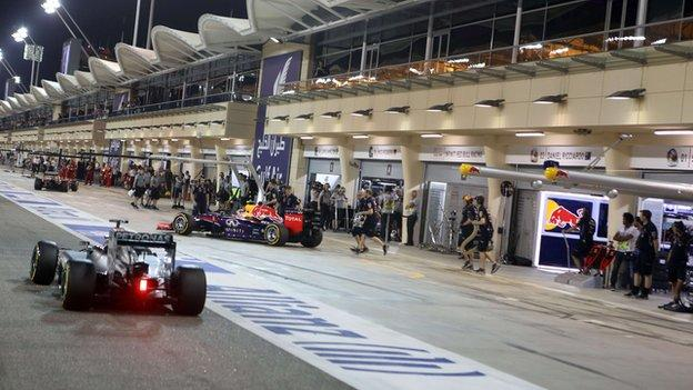 F1 cars at the pit during the Formula 1 Bahrain Grand Prix at the Sakhir circuit in Manama
