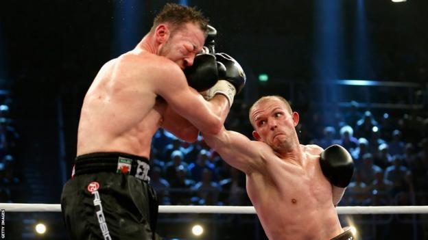Champion Jurgen Brahmer goes to work on Enzo Maccarinelli's damaged right eye and increases the swelling
