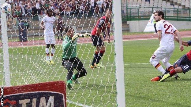Mattia Destro (right) of Roma scores the opening goal