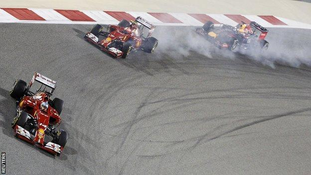 Fernando Alonso leads fellow Ferrari driver Kimi Raikkonen at the Bahrain GP