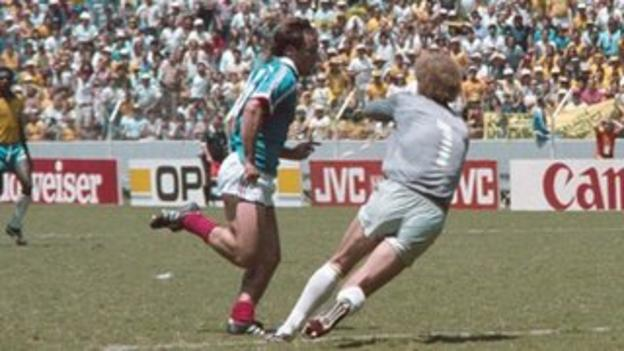 France's Bruno Bellone is fouled by Brazil's Carlos