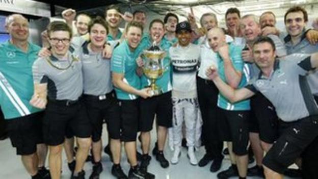 Lewis Hamilton (centre) celebrates after winning the Bahrain GP