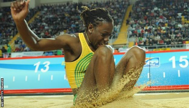 Jamaica's Kimberley Williams lands in the sand during the women's triple jump final at the 2012 IAAF World Indoor Athletics Championships at the Atakoy Athletics Arena in Istanbul