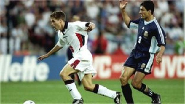 England's Michael Owen goes past Argentina's Jose Chamot to score