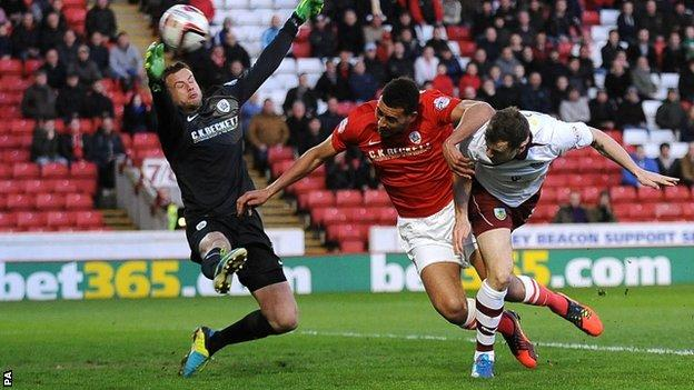 Ashley Barnes heads Burnley into the lead at Barnsley