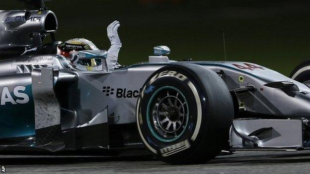 Mercedes driver Lewis Hamilton waves after he wins the Bahrain Formula One Grand Prix