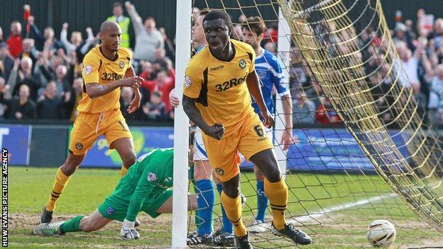 Ismail Yakubu celebrates scoring for Newport County