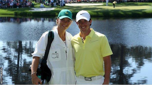 Rory McIlroy and fiancee Caroline Wozniacki smile together during the 2013 Par Three tournament
