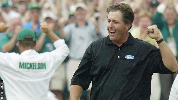 Phil Mickelson celebrates a birdie putt on the 18th green to win the 2004 Masters