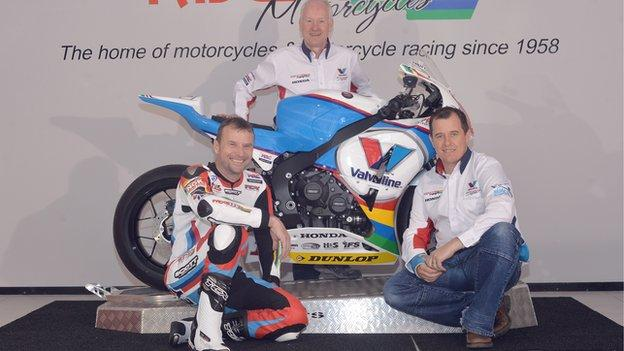 Bruce Anstey, team boss Clive Padgett and John McGuinness with the new Valvoline liveried Padgett's Honda that they will race in 2014