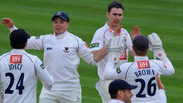 Steve Magoffin celebrates with his Sussex team-mates
