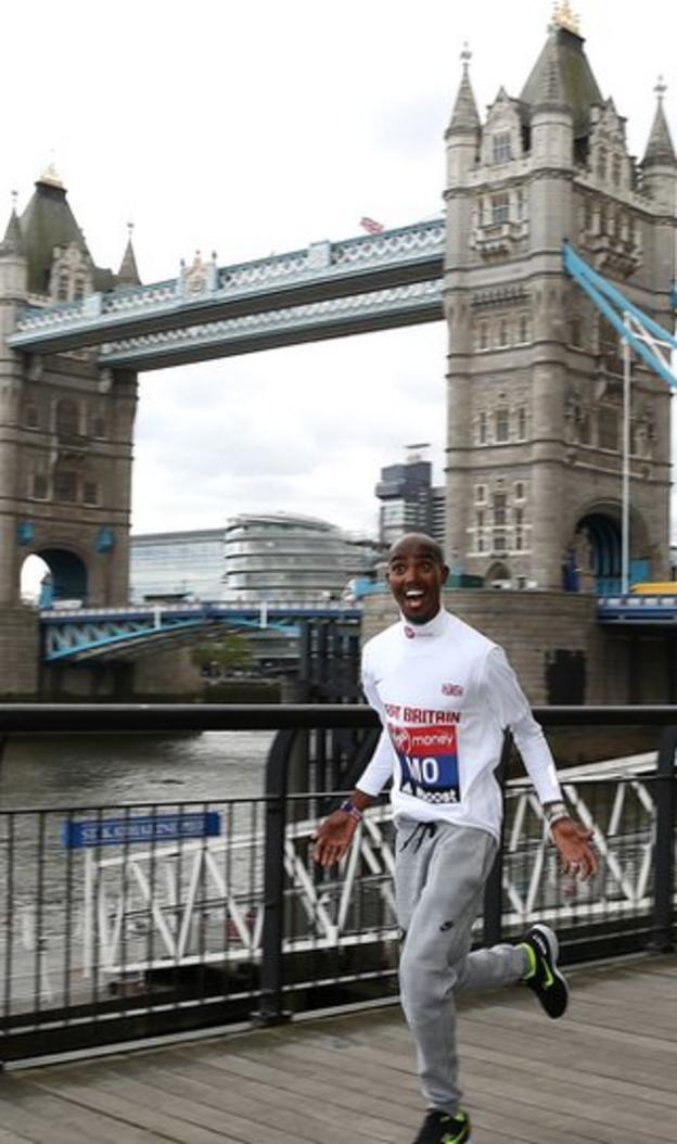 Mo Farah runs past Tower Bridge in London as he prepares to race in the London Marathon